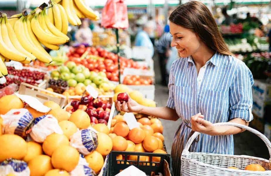 Woman Choosing Fruit at the Market