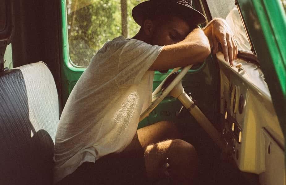 Man Sleeping in a Truck