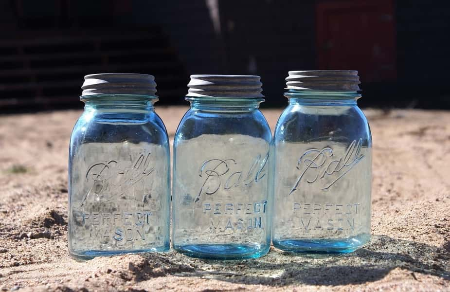 Three Mason Jars in Sand