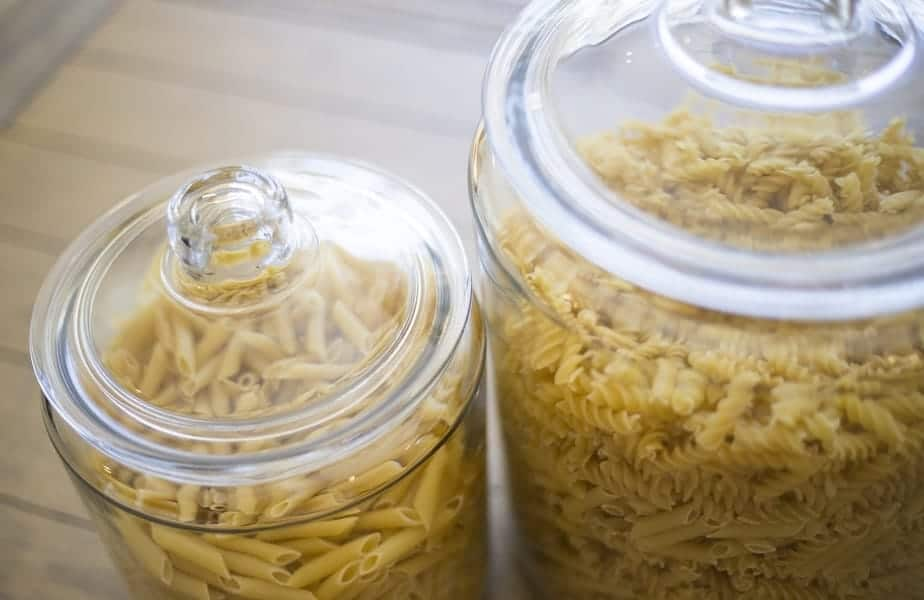 dry pasta in glass storage containers
