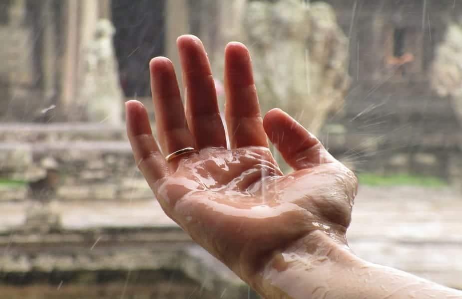 rain falling on a hand