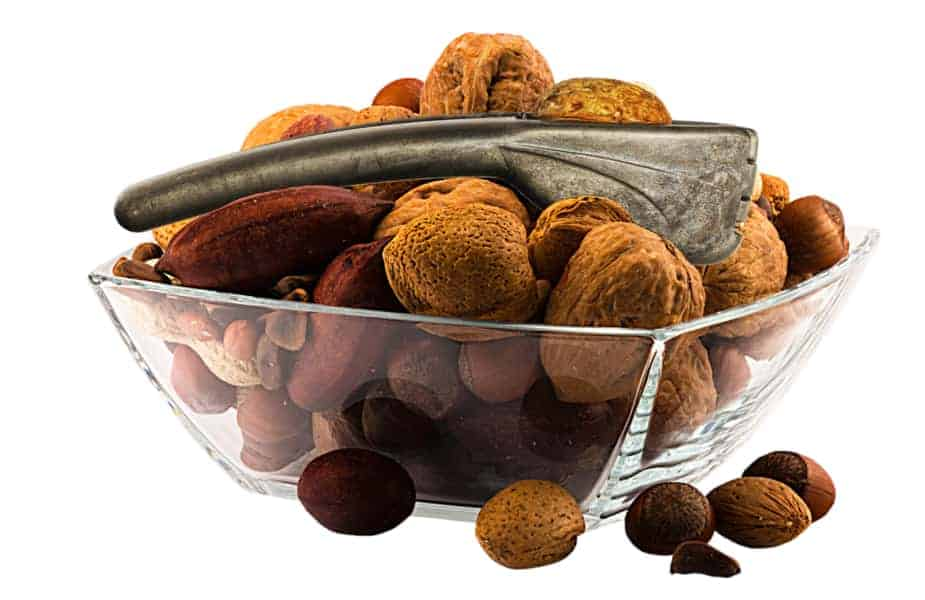 mixed nuts in a bowl with nutcracker