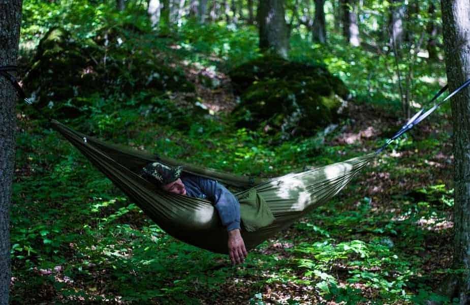 Man Sleeping in Insulated Hammock