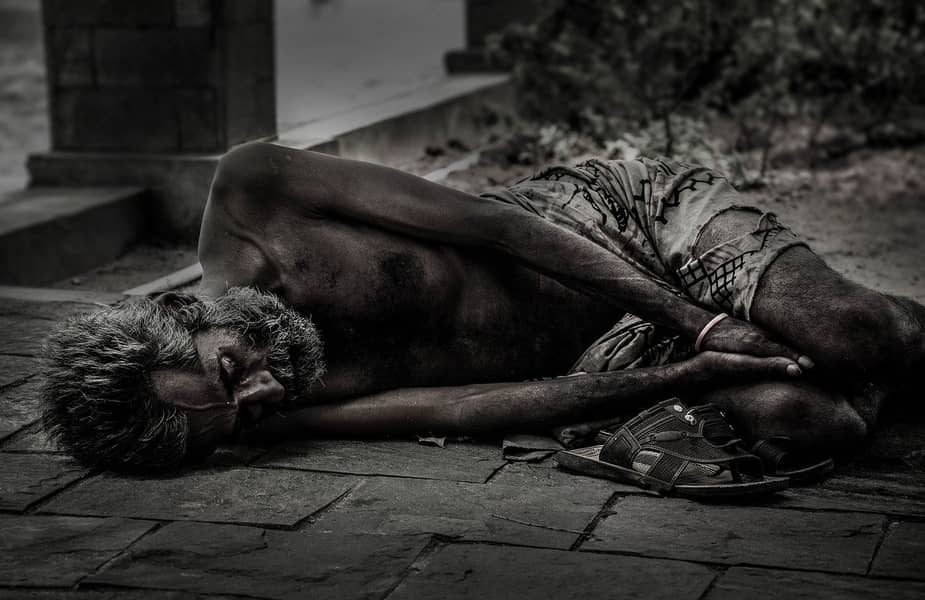 Starving Man Laying Down