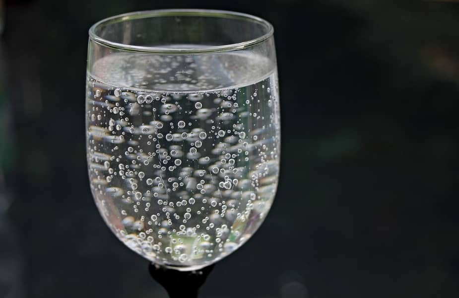 Wine Glass with Water and Bubbles
