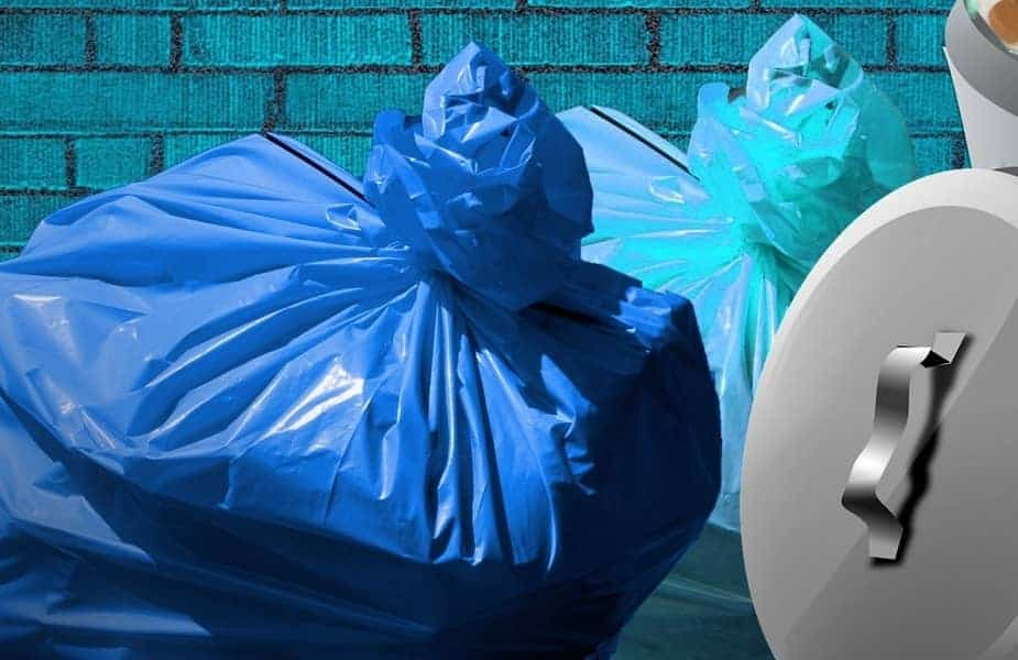 Blue Trash Bags Next to Garbage Can