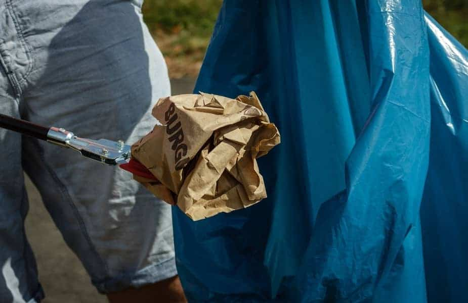 Brown Paper Bag Being Picked Up