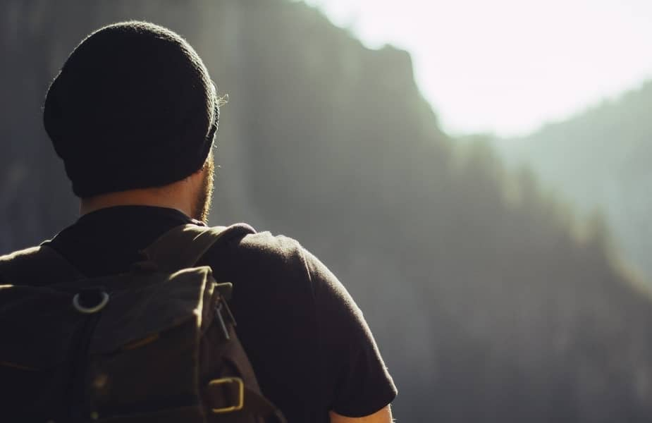 Man Hiking Looking into Distance with Backpack