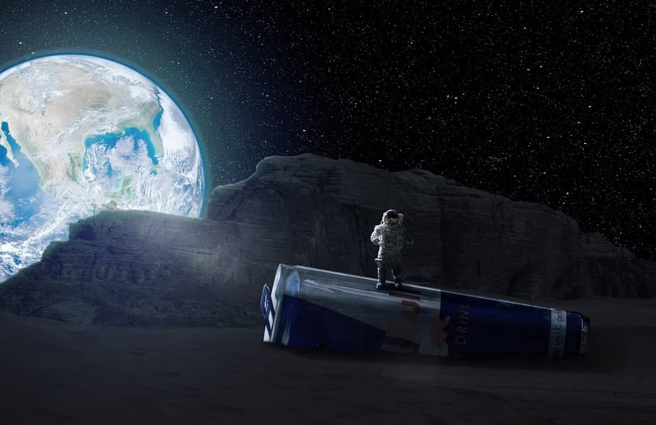 Can of Red Bull Under an Astronaut on the Moon