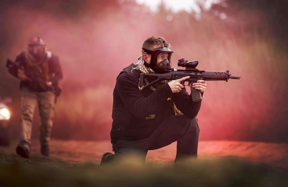 Men Wearing MIRA Safety CM-6M Tactical Gas Masks in Smoke