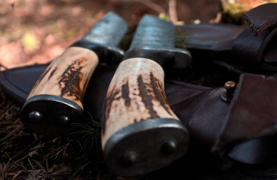 Survival and Bushcraft Knives Laying Next to Each Other