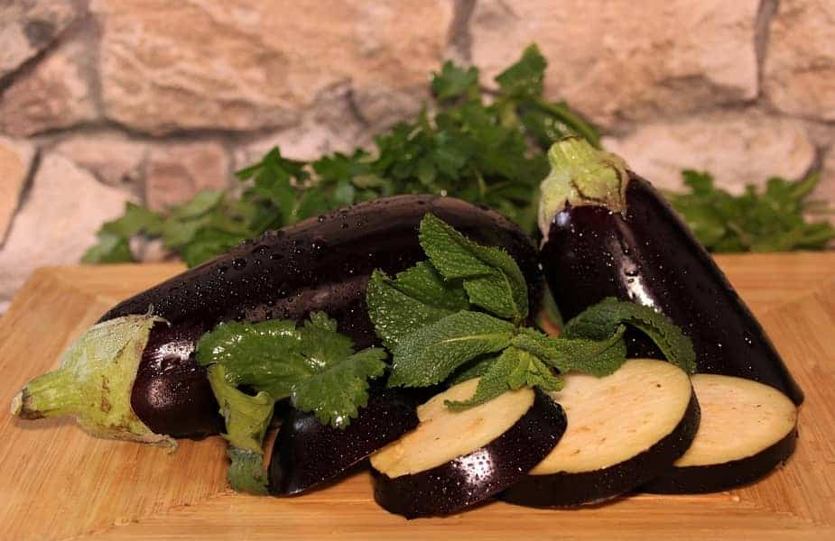 Whole and Sliced Eggplant on a Table