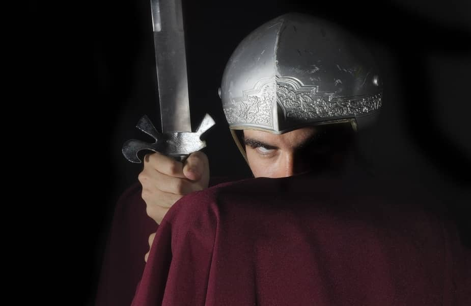 Gladiator Holding a Sword with Arm in Front of Face
