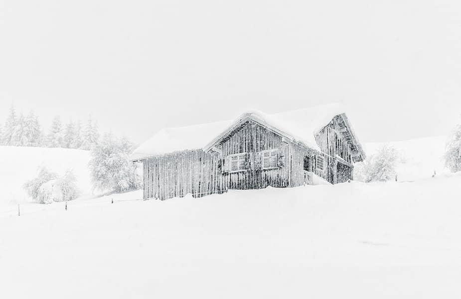 House in Winter Storm