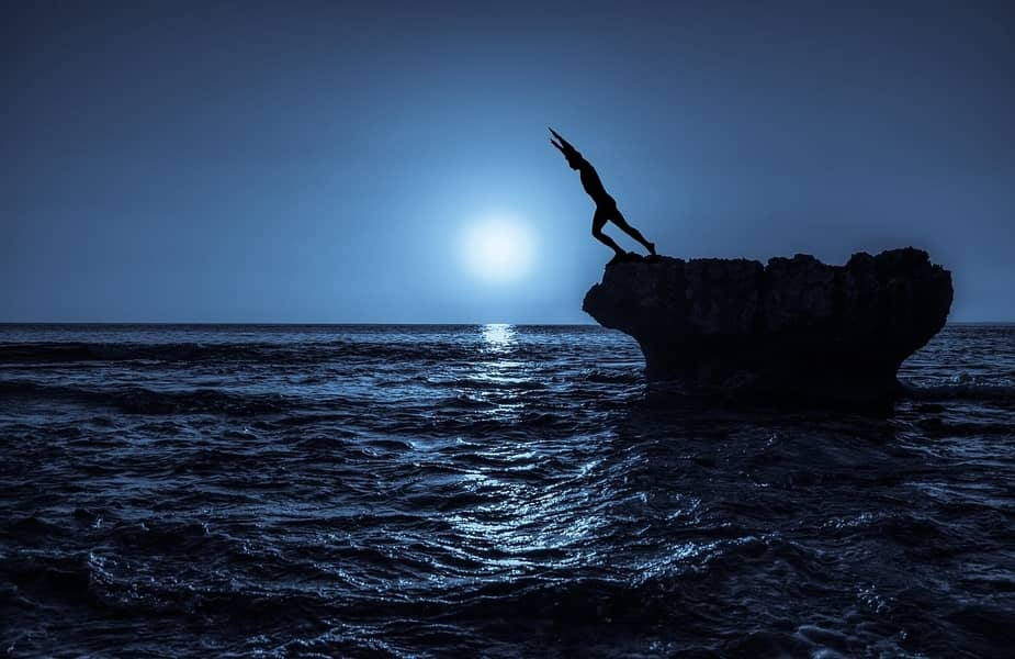 Person Jumping in the Ocean at Night