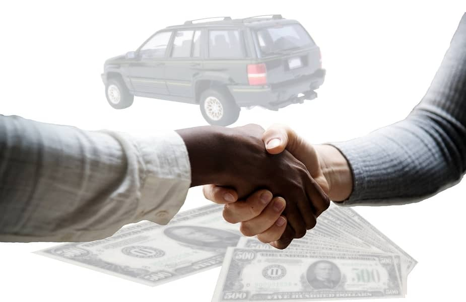 Two People Shaking Hands with a Car and Money in the Background