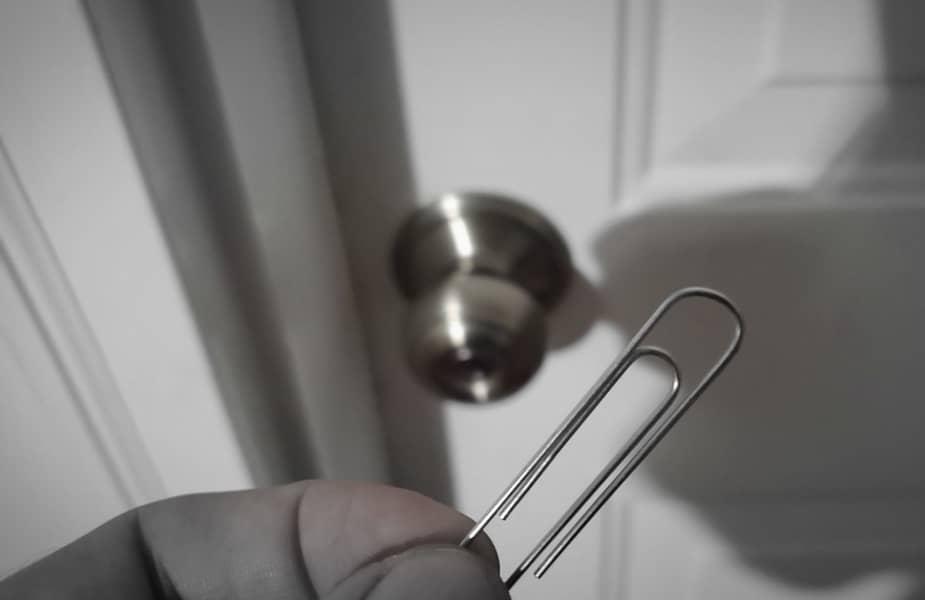 Paperclip Held in Front of a Door Knob