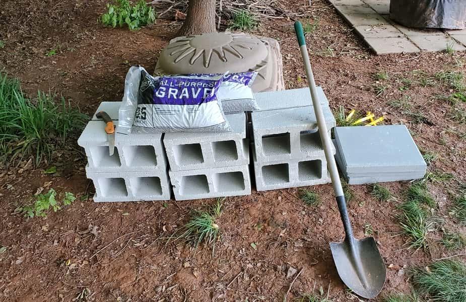 Stack of Cinder Blocks with a Shovel