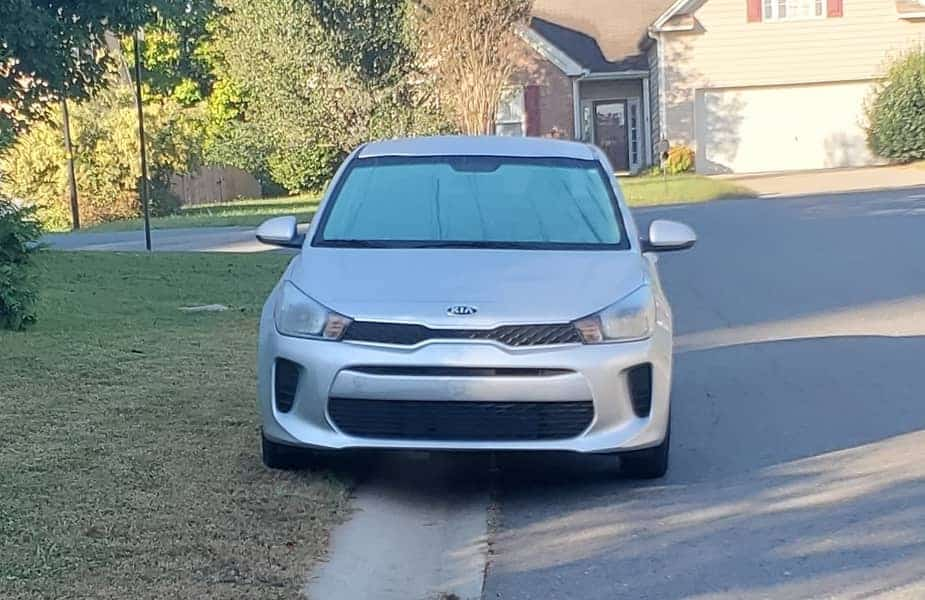 Car Parked on Lawn Edge