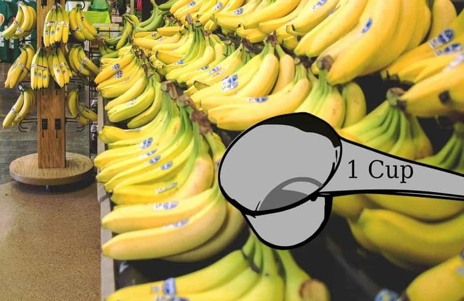 Measuring Cup in Front of Bananas in a Grocery Store
