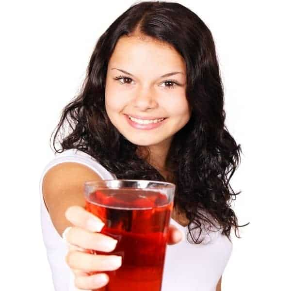 Girl-Offering-a-Glass-of-Cranberry-Juice
