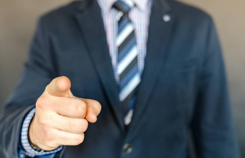 Man in a Suit Pointing a Finger at You