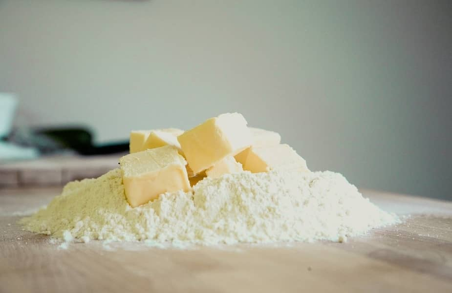 Margarine or Butter in Flour on a Table