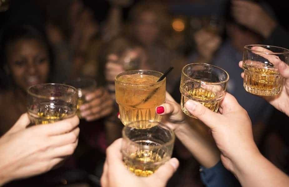 People Toasting Before Drinking Alcohol