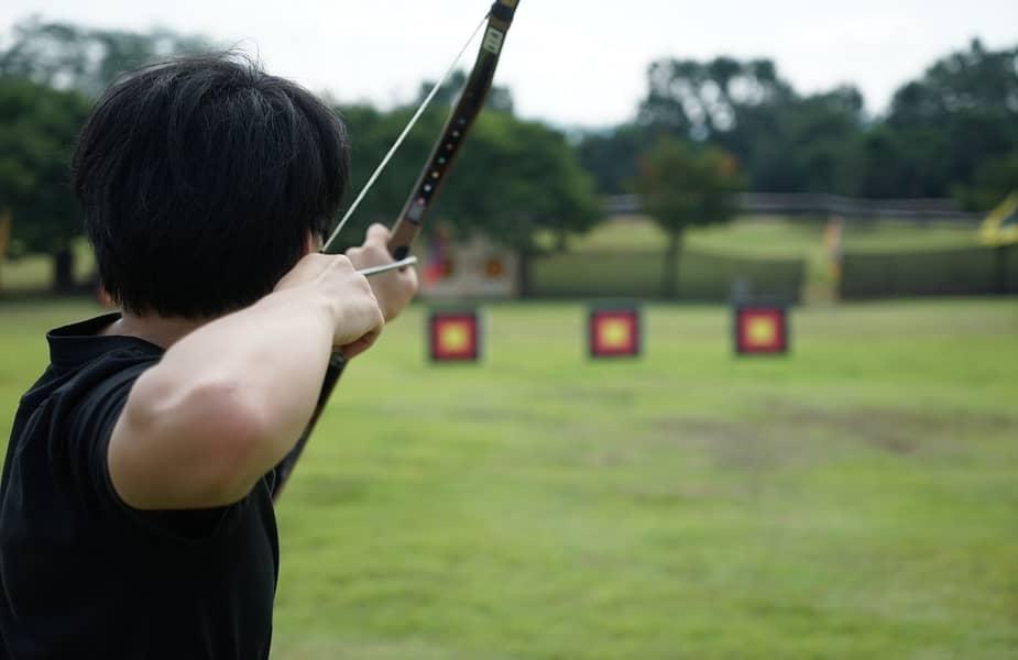 Archer Shooting Arrow Down a Range