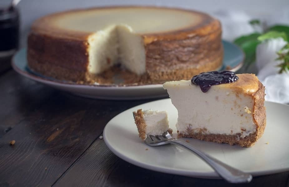 Piece of Cheesecake on a Plate with Blueberry Topping