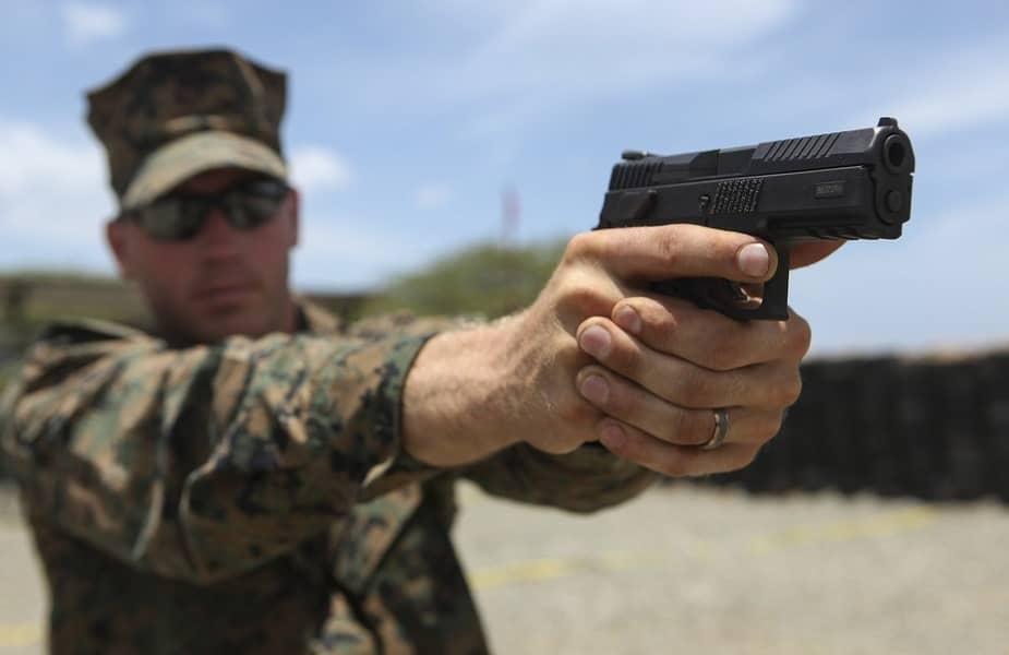 Military Man Aiming a Handgun