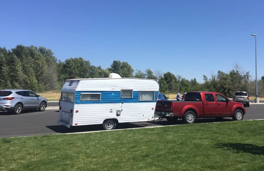 Pickup Truck Pulling a Small Camper