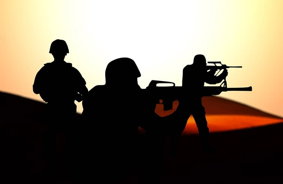 Soldiers Silouette Firing Two Different Types of Guns