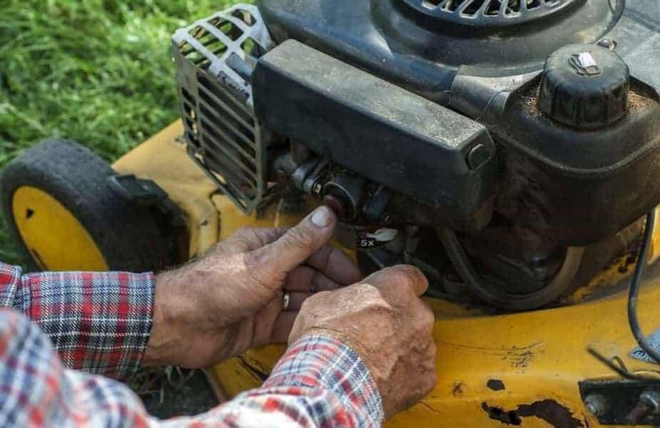 Man Fixing Lawn Mower Engine