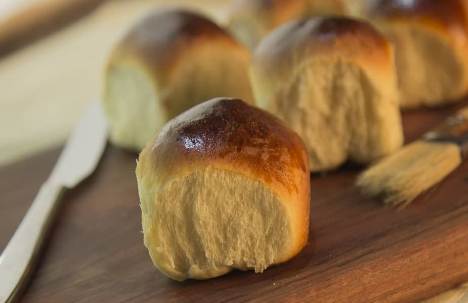 Brown and Serve Rolls on a Table
