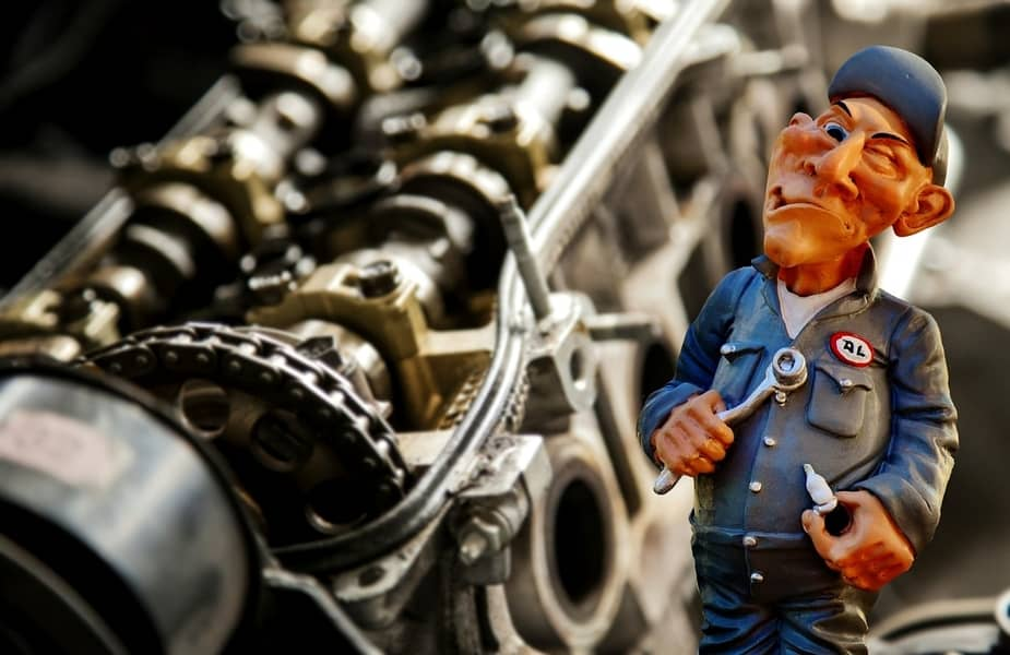 Cartoon Mechanic in Front of an Engine