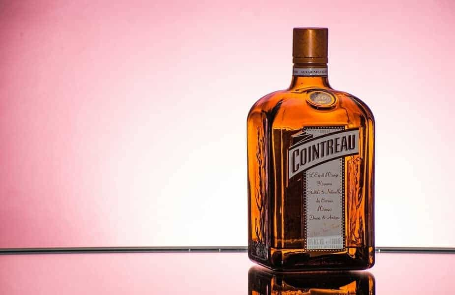 Cointreau Bottle With a Pink Background