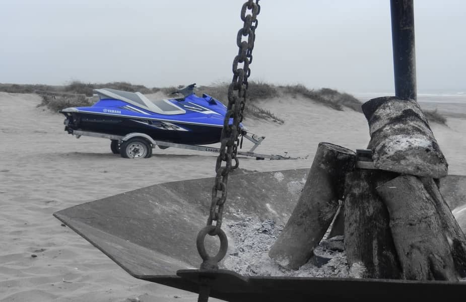 Fire Pit With Jet Ski in the Background