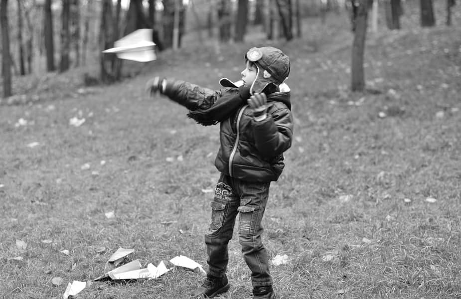 Boy Flying Paper Airplane